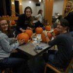 Women in Science and Engineering annual pumpkin carving enjoyed with apple cider and pumpkin bars (Yum!)